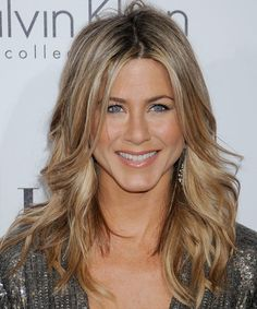 Jennifer Aniston - Casual Long Wavy Haircut, Haircuts- I like the part slightly to the side instead of in the middle, but I like the layering