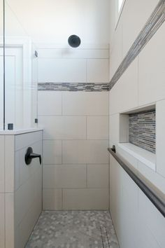 This accessible bathroom has a large zero entry walk-in shower. The curbless shower will allow the homeowners to age in place. The shower has a wide door, bench seating and a handheld showerhead. Small tile on the shower floor and grab bars will prevent slips. A sliding barn door provides easy access to the bathroom from the master bedroom. #adabathroom #wheelchairaccessible #adashower #curblessshower Large Tile Bathroom, Small Tile Shower, Master Shower Tile, Tile Walk In Shower, Shower Grab Bar, Ada Bathroom, Shower Tile Designs, Large Shower, Shower Floor