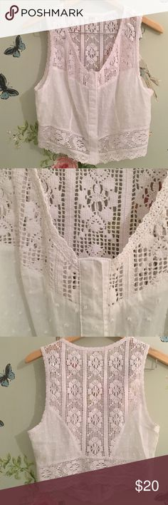 White Crochet Clasp-Closure Top/Vest This is your new go-to vacation top. Excellent crochet detail and soft linen fabric. Amazing quality. Clasp closure up the entire middle. 100% Cotton. BB Dakota Tops Crop Tops