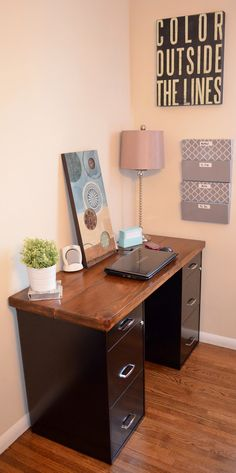 """Desk w file cabinets ... Love how this clutter free anally clean person has a sign that says """"color outside the lines"""". Ha. But I love the desk.  Boy friendly."""