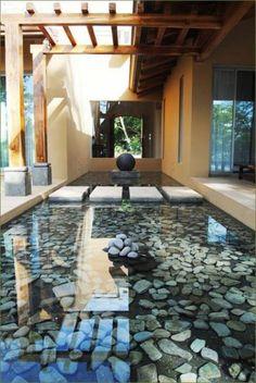 bassin affleurant et passage sur dalles