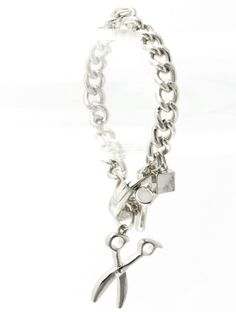 Looking for a great gift for your favorite hair stylish or cosmetology grad ? Modern , Stylish and Chunky this Dangling Scissor Bracelet is awesome.