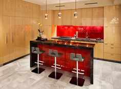 A captivating backsplash in red for the Asian style kitchen
