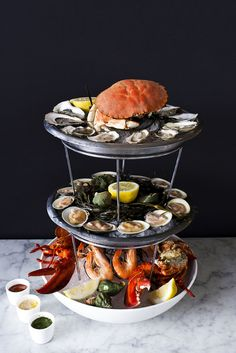 The John Dory Oyster Bar....seafood tower. Chef Barry at N9NE Steakhouse, The Palm's in Las Vegas, NV, Made one of these for my Wife and I on our 42 wedding anniversary. For seafood lovers it is dying and going to heaven.