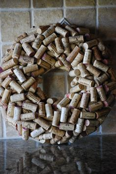 My next project for Thanksgiving, I'm collecting corks now.  Will prob make mine bigger/thinner and run a large, ornate ribbon around it (no bow).  Something orange and gold perhaps.