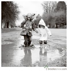 wouldn't it be fun, after the reception, to have pics taken jumping in mud puddles together?