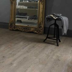 Karndean Van Gogh Distressed Oak VGW82T Vinyl Flooring has a  pronounced grain with deliberate knot and line details in its design. The authentic rustic finish mean you can have the appearance of a real oak floor with none of the drawbacks of real timber.