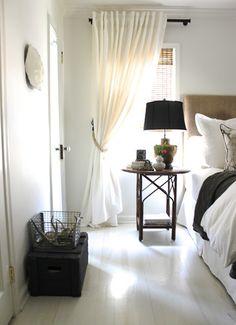 curtains behind headboard in master bedroom