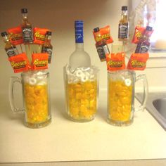 Made this for my bf on his birthday. Used dollar store mugs and a pitcher, filled them with butterscotch and put lifesaver mints at the top to look like foam. Put a bottle of grey goose in the middle because it fit best and made mini bouquets with mini liquor bottles. Super easy to make and a cute idea for a guy gift!