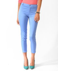 A pair of solid capri trousers featuring a banded waistline with belt loops. Zip fly, button closure. Decorative back welt pockets. Finished leg openings. Partially lined. Woven. Lightweight.