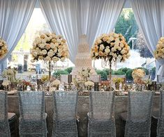 Guests were greeted with seating cards in the foyer and a cluster of vases full of fresh white roses, hydrangeas and peonies.
