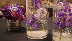 Centerpieces, submerged purple orchids,  ISES International Special Events Society of Philadelphia gala