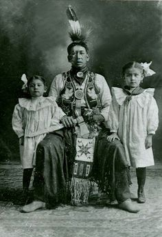 An unidentified man if the Ho-Chunk Tribe with his daughters. No date or additional information.