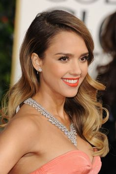 Jessica Alba's ombré hair color really stood out in this side-swept style.