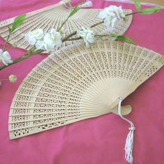 Carved Sandalwood Fan Favors (Event Blossom EB1055) | Buy at Wedding Favors Unlimited (http://www.weddingfavorsunlimited.com/carved_sandalwood_fan_favor.html).