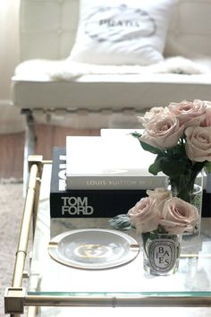 Living room coffee table black white gold pink roses Gucci Prada Tom Ford LV