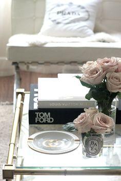 Living room coffee table black white gold pink roses Gucci Prada Tom Ford LV