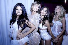 Adriana, Karlie, Lily & Doutzen make a very sexy conga line.