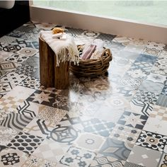 A Moroccan patchwork floor with geometric patterns. Arabesque tiles are perfect for creating a statement floor in a kitchen or bathroom.