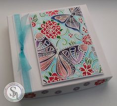 Gift Box made with Spectrum Noir Colorista stamps Background 2 & Elements 2. Spectrum Noir Sparkle Pens – Holiday Set – Holly Leaf, Pine, Berry, Macaroon, Gold, Fig, Hearthside, Starry Sky, Smoked Quartz & Clear Overlay. Designed by Marie Jones. #crafterscompanion #spectrumnoir #colorista