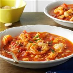 Seafood Cioppino Recipe -If you're looking for a great seafood recipe to create in your slow cooker, this classic fish stew is just the ticket. It's full to the brim with clams, crab, fish and shrimp, and is fancy enough to be an elegant meal. —Lisa DiPrima, Milford, New Hampshire