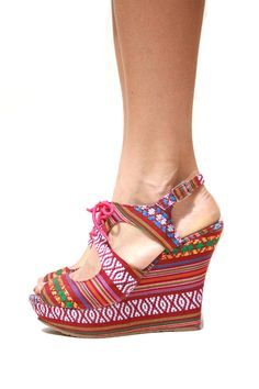 Rosarito Wedge - Muchos gracias, mi amor. These sandal wedges bring a little español to your closet. Looks great when paired with a pair of cut offs and an off the shoulder top. tie up front.