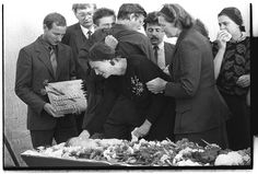 "1988: Relatives attend the funeral of radiation expert Alexander Goureïev, one of the liquidators who cleared the roof of reactor 3. These experts were often referred to as ""roof cats"". Goureïev died as a result of contracting a radiation-related illness.  Photograph: Igor Kostin/Corbis"