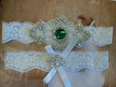 Wedding Garter, Bridal Garter, Garter Set - Crystal Rhinestones with Emerald Green Stone on a White Lace - Style G8885. $26.00, via Etsy.