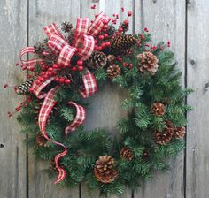 Rustic Country Faux Evergreen Christmas Wreath Decorated with Lovely Red and Ivory Plaid Ribbon, Red Berries, and Pinecones Topped With a Touch of Gold Sparkle. Dimensions: 25 inches tip to tip