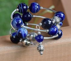 Navy Blue and White Faceted Agate Memory Wire Bracelet. 12mm Agate Gemstones, 10mm Silver Plated Spacer Beads, and Curved tubes.