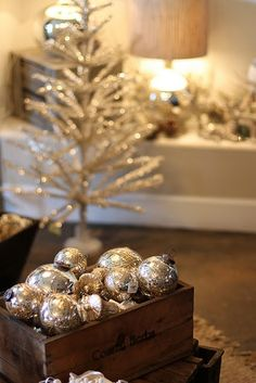 idea to note: place mini silver tree in antique box with shredded book paper and silver/white ornies