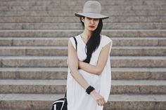 FrouFrouu:  One day at NYFW.   Dress: vintage nightdress  Hat: vintage  Boots: vintage #Nadia Sarwar
