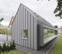 """Example of grey standing seam metal cladding for siding. With less """"modern"""" roofline this could be a possible alternative to the board and batten application. Dentist with a View by Shift Zinc Cladding, House Cladding, Metal Siding, Metal Roof, Zinc Roof, Modern Barn House, Suburban House, House Extensions, Historic Homes"""