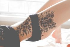 beautiful black floral tattoo (huge) on the thighs and side of the waist