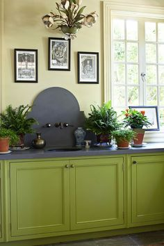 A potting room with counters of Caesarstone. Makes potting a breeze all season long.
