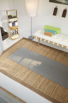 Namaste in this She Shed. A sleek bench, large-scale artwork, and a natural fiber mat offer a calming space to achieve maximum focus.