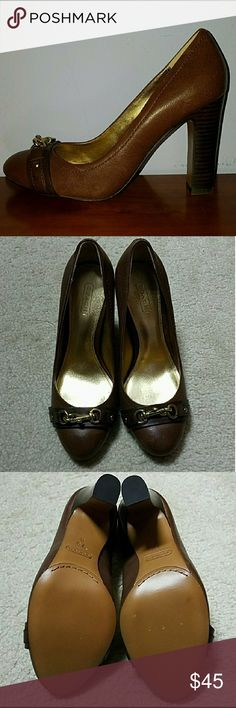 NWOT - COACH BROWN LEATHER W/GOLD BUCKLE ACCENT NWOT - COACH BROWN LEATHER W/GOLD BUCKLE ACCENT CLOSED TOED HEELS.  GREAT FOR THE OFFICE Coach Shoes Heels