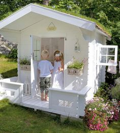 Playhouse. Love the little cottage look with flower boxes. Just needs it's own little mail box.