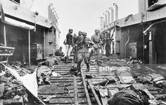 German soldiers inspect the landing craft carrying the bodies of dead Canadian and British soldiers after the Dieppe raid 1942 Luftwaffe, Dieppe Raid, Canadian Army, Landing Craft, War Film, Major Events, British Soldier, German Army, World War Two