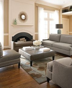Grey furniture with tan walls and white trim
