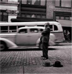 (Downtown Street Scene: Evangelist at Corner of Smithfield and Diamond Streets) ELLIOTT ERWITT (AMERICAN, B. FRANCE, b. 1928) 1950