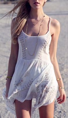 White cotton embroidered summer dress. Street style