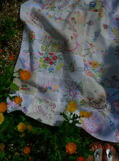 Vintage embroidered table clothes collected, cut up, and sewn into a quilt.