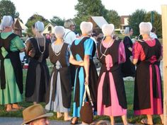 """Different colored Amish dresses...""""For many years the accepted wear for our Amish women was rich and royal blue, green or purple under a black apron for every day wear. Now every color seems acceptable....""""  (amishwisdom.com)"""