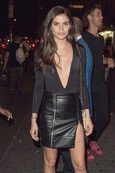 Sara Sampaio wearing leather mini skirt, leather skirt.