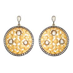 Vermeil and oxidized silver earrings with CZ tops and three CZ stones set in the center of the circle. Little sparkling CZs set on the rim. $225.00