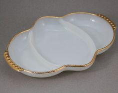 A Set of Two Vintage Oven Proof Anchor Hocking White Milk Glass Handled Bowl Pot