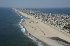 The U.S. Army Corps of Engineers Philadelphia District pumps sand onto Brant Beach, NJ in June of 2013. The work is part of an effort to restore the Coastal Storm Risk Management project from damages associated with Hurricane Sandy.