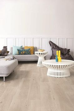 "This Largo Long Island Oak laminate flooring from [Quick-Step](http://www.quick-step.com.au/?utm_campaign=supplier/|target=""_blank"") makes use of a grey wash to soften the tones of natural oak."