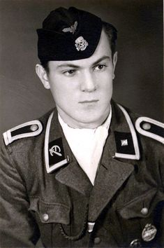 A studio portrait of Ants-Eduard Teder, 13 August 1944 who served in the Estonian SS Volunteer Brigade. After serious defeats on multiple fronts Himmler decided to ease his pompous recruiting standards and enlist as many foreign volunteers sympathetic to the Nazi cause as possible. The Estonian SS were among just a few of these 'Freiwillige' foreign volunteers willing to join the National Socialist cause.